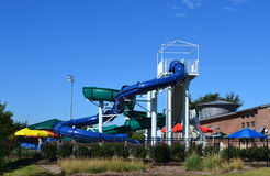 Water slides at a community waterpark. A recreation center and waterpark in Flower Mound, TX Stock Image