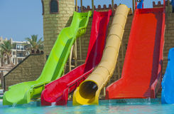 Water slides at a large swimming pool in luxury tropical hotel Stock Images