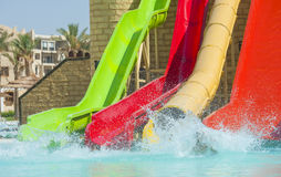 Water slides at a large swimming pool in luxury tropical hotel stock image