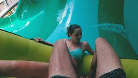Water slides pov. Guy with girl on the inflatable circle descends from the water slides. Thailand. Water slides pov. The guy with the girl on the inflatable stock video