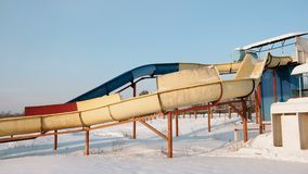 Water slides on a snowy beach in winter day. Side view. Water slides on a snowy beach in winter day. Side view stock video