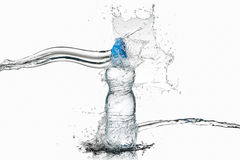 Water. Small plastic water bottle with water drops and splash on Royalty Free Stock Image