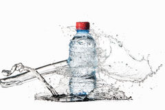 Water. Small plastic water bottle with water drops and splash on Royalty Free Stock Photo