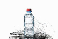 Water. Small plastic water bottle with water drops and splash on Royalty Free Stock Images