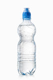 Water. Small plastic water bottle with water drops on white back Royalty Free Stock Image