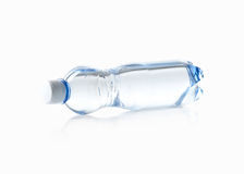 Water. Small plastic water bottle on white background Stock Photos