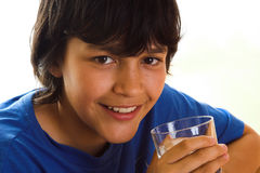 Water with a smile. Boy drinking water with a smile Royalty Free Stock Photo