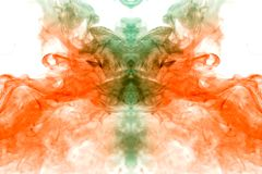 Water-smoky substance on a white background of fiery orange and green color in the form of the head of a mystical ghost with. Distinct eyes royalty free stock image