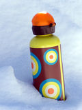 Water and Snow. Colorful water bottle standing in the frigid snow Royalty Free Stock Photos