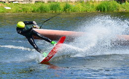 Water snowboard. The athlete with snowboard hold on to the rope and the boat accelerates Royalty Free Stock Photos