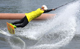 Water snowboard. The athlete with snowboard hold on to the rope and the boat accelerates Stock Photography