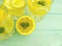 Water soda lemon sliced organic refreshment , freshness homemade health mint summer on a blue wooden background. Water lemon antioxidant mint blue wooden Royalty Free Stock Images