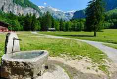 Water source at mountain trail. Water source at mountain hiking trail. Sixt Fer a Cheval Natural Reserve Royalty Free Stock Photography