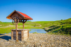 Water source well and green grass Royalty Free Stock Images