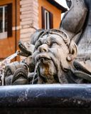 Fish fountain in Rome stock images