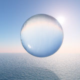 Water Sphere above the Sea Royalty Free Stock Photography