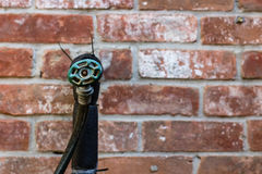 Water Spigot with hose Stock Image