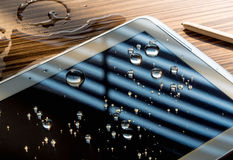 Water spilled onto the tablet Stock Photos