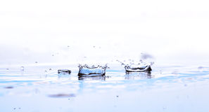 Water Splash. S with reflection; blue and white background Royalty Free Stock Images