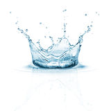Water splash. On white background with ripple and reflection stock images