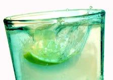 Water Splash. Water with lemon splashing into glass Stock Photos