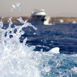 Water Splash. With Sea Yacht at the Background Stock Images