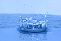 Water splash. Water drop splash crown in blue tones Royalty Free Stock Photography