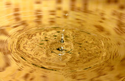 Water splash. Es on a yellow background Stock Photography