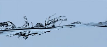 Water splash. On blue movement of water Royalty Free Stock Photography
