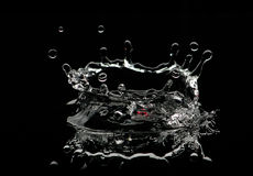 Water droplet splash. Water splash created by a water droplet stock photography