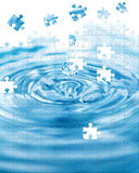 Water splash. With puzzle effect Royalty Free Stock Image