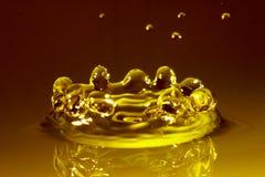 Water splash. Amber water Stock Photography
