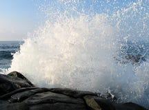 Water Splash. Sea water splash against rocks Stock Image