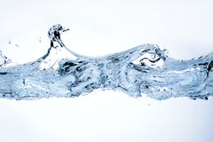Water splash. Close-up of water splash against white background Royalty Free Stock Photos