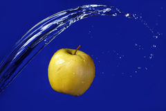 Water splash on apple Stock Photos