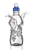 Water splash around bottle (concept) Stock Images