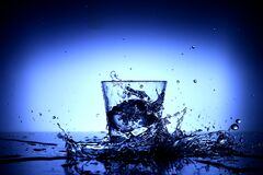 Water splash around glass Royalty Free Stock Image