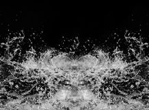 Water splashes on a black background. royalty free stock images
