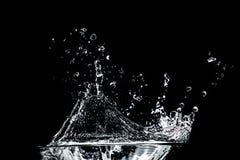 Water splash on black Royalty Free Stock Photo