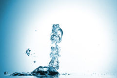 Water splash on blue background Royalty Free Stock Image
