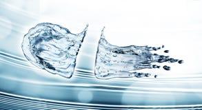 Water splash on blue background Stock Image