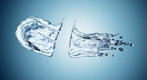 Water splash on blue background Stock Photos