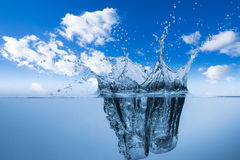 Water splash and blue sky Stock Photos