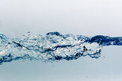 Water splash with bubbles of air, isolated on the white background royalty free stock image