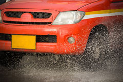 Water splash with car on flooded road after rains Stock Photo