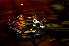 Water splash in color with a drop of water. Flying from above stock images