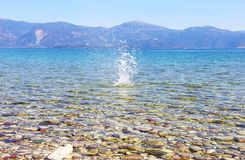 Water splash on crystal clear water of Peloponnese Greece Stock Images