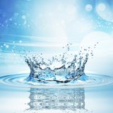Water splash in dark blue color with a drop of water flying from above. 3d rendering Royalty Free Stock Image
