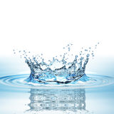 Water splash in dark blue color with a drop of water flying from above Royalty Free Stock Image