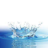 Water splash in dark blue color with a drop of water flying from above Stock Image